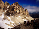 Hikers Resting at Bamberger Saddle, Gruppo Sella, Dolomites, Italy Photographic Print by Witold Skrypczak