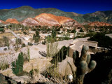 Seven Colours Hill Above Andean Village of Quebrada De Humahuaca, Purmamarca, Argentina Photographic Print by Michael Taylor