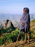 Shepherd Boy with Simien Mountains Background, Simien Mountains National Park, Ethiopia Papier Photo par Frances Linzee Gordon