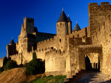 Tourists Enter Medieval Walled City at Sundown Via Porte D'Aude, Carcassonne, France Photographic Print by Dallas Stribley