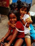 Portrait of Children Sitting on Motorbike, Chowringee, India Reproduction photographique par Anthony Plummer