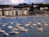 Boats and Waterfront Buildings at Playa De La Concha, San Sebastian, Spain Photographic Print by Dallas Stribley