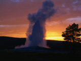Old Faithful Geyser at Sunset, Yellowstone National Park, USA Photographic Print by Carol Polich