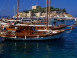 Wooden Yachts Moored in Front of Pigeon Island, Kusadasi, Turkey Photographic Print by Wayne Walton