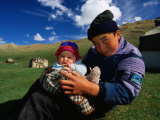 Boy and Baby in Front of Yurt Camp, Kyrgyzstan Fotografisk tryk af Anthony Plummer