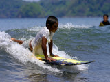 Boy Learning to Surf, Morro Negrito, Panama Photographic Print by Paul Kennedy
