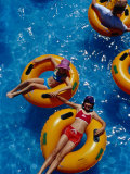 Young Girls Floating in Rubber Rings in Swimming Pool, Gold Coast, Australia Photographic Print by Richard I'Anson