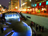 The Cheonggyecheon Stream Draws Crowds of Locals out in Early Evening, Seoul, South Korea Photographic Print by Anthony Plummer