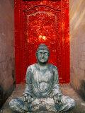 Buddha at Ornate Red Door, Ubud, Bali, Indonesia Photographic Print by Tom Haseltine