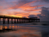 Pier at Sunrise with Reflections of Clouds on Beach, Tybee Island, Georgia, USA Photographic Print by Joanne Wells