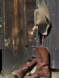 Cowboy Boots and Hat, Montana, USA Photographic Print by Adam Jones