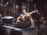 "Kirk Douglas Dunking Enemy's Head in Giant Cook Pot in Scene From Stanley Kubrick's ""Spartacus"" Premium Photographic Print by J. R. Eyerman"