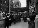 Actress Grace Kelly in Casual Pose with Armful of Roses Standing on Sidewalk During Shopping Trip Premium Photographic Print by Lisa Larsen