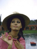 Sophia Loren Wearing a Pink Wrap and Straw Hat Out by the Pool at the Villa Premium Photographic Print by Alfred Eisenstaedt
