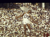 Greg Bell Competing in the Long Jump at the Summer Olympics Premium Photographic Print by John Dominis