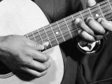 Close Up Shot of Musician Leadbelly, aka Huddie Ledbetter's Hands While Playing Acoustic Guitar Premium Photographic Print by Bernard Hoffman