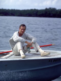 Actor Paul Newman Enjoying a Heineken Beer on the Prow of a Boat Premium Photographic Print by Mark Kauffman