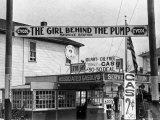 Girl Behind the Pump Gas Station Run Entirely by Female Owners Premium Photographic Print by E O Hoppe