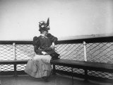 Woman in Dress and Ornate Hat, Looking Across Water as She Travels by Bertha Roth to Midland Beach Premium Photographic Print by Wallace G. Levison