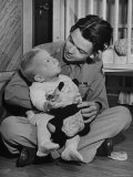 Army Sgt. Bill Mauldin, Pulitzer Prize Winning War Cartoonist, Holding His Son on His 1st Day Home Premium Photographic Print by Martha Holmes