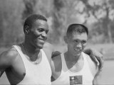 Rafer Johnson with Arm Around Unidentified Athlete at 1960 Olympics Premium Photographic Print by Mark Kauffman