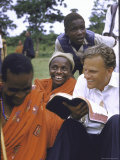 Evangelist Billy Graham Showing His Bible to the Waarusha Warriors Near Mt. Meru Premium Photographic Print by James Burke