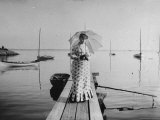 Young Woman, Dressed in a Print Dresses Standing on a Boat Landing by a Body of Water Premium Photographic Print by Wallace G. Levison