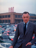 President of Fiat Gianni Agnelli Standing with Cars and Fiat Factory in Background Premium Photographic Print by David Lees