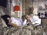 Actress Sophia Loren and Husband Carlo Ponti Lying Across a Bed Together Premium Photographic Print by Alfred Eisenstaedt