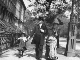 Incredibly Well Dressed Man, Woman and Child Walking by Perfect Brownstone Apartment Buildings Premium Photographic Print by George B. Brainerd