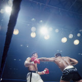 Boxers Sonny Liston and Cassius Clay During Match Premium Photographic Print by John Dominis