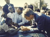 Presidential Contender Bobby Kennedy Stops During Campaigning to Shake Hands African American Boy Photographie par Bill Eppridge
