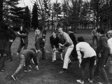 William Buckley Jr Playing Touch Football with Members of Buckley Clan at Family Estate Premium Photographic Print by Alfred Eisenstaedt
