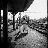 Insurance Broker Charles Hoffman's Wife Bringing Children to Train Station to Wait for His Arrival Photographic Print by Nina Leen