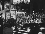 Crowd Watching From Bleacher Seats Set Up on the Right Side of Entrance to the RKO Pantages Theatre Premium Photographic Print by Ed Clark