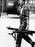 Yankee Papa 13 Helicopter Crew Chief James Farley Carrying a Pair of M-60 Machine Guns Premium Photographic Print by Larry Burrows