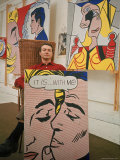 Roy Lichtenstein Holding Completed Painting Premium Photographic Print by John Loengard