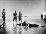 Six Men in assorted bathing suits Hang Around a Large Puddle on Beach Near the Narragansett Pier Premium Photographic Print by Wallace G. Levison