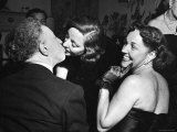 Rubinstein KissingTallulah Bankhead at a Party Thrown by Gossip Columnist Hedda Hopper for Bankhead Premium Photographic Print by Ed Clark