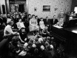 Jimmy Childs, 9, Giving Piano Recital to Large Group of Neighbors and Parents Premium Photographic Print by Yale Joel