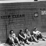 Workers Sitting Against Wall During Lunch Break, at Vega Aircraft Plant, During WWII: Burbank, Ca Photographic Print by Charles Fenno Jacobs