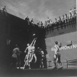Navy Pilots Playing a Game of Basketball in the Elevator Well of the Aircraft Carrier USS Monterey Reproduction photographique sur papier de qualité par Victor Jorgensen