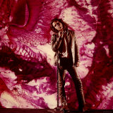 Rock Star Jim Morrison of the Doors Standing Alone in Front of a Purple Psychedelic Backdrop Premium Photographic Print by Yale Joel