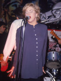 Actress Kathleen Turner Singing with Her Husband's Band Named the Suits at the Harley Davidson Cafe Premium Photographic Print by Dave Allocca