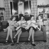 Daughters of James Ferdinand Irwin Bottle Feeding Their Babies at Christmas Family Reunion Photographic Print by Myron Davis