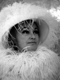 Comedian Phyllis Diller Wearing a Feathered Hat and Boa Premium Photographic Print by Bill Eppridge