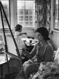 Jackie Kennedy, Wife of Sen, Painting on an easel as Daughter Caroline Paints on Table at Home Photographic Print by Alfred Eisenstaedt