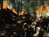 Captain Vernon Gillespie Contacting His Base Camp While Vietnamese Soldiers Burn Viet Cong Hideout Premium Photographic Print by Larry Burrows