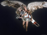 "Actress Jane Fonda Being Carried by Guardian Angel in a Scene from Roger Vadim's Film ""Barbarella"" Premium Photographic Print by Carlo Bavagnoli"
