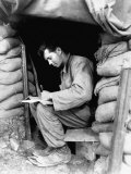 Pfc. Dwight Exe of 5th Cavalry Regiment Sitting in Entrance to Sandbagged Shelter Premium Photographic Print by James L. Chancellor